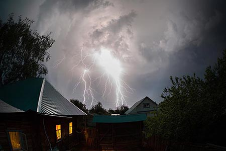 Powerful thunderbolts over houses